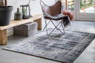kelim vloerkleed vintage stoer grijs woonkamer