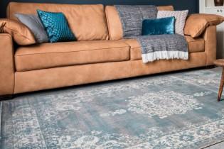 kelim vloerkleed medaillon vintage stoer grijs blauw woonkamer